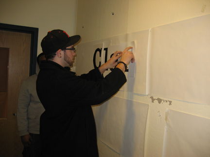 students manually kerning painted letterforms